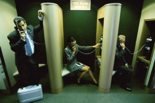 Business executives talking on pay phones : Stock Photo