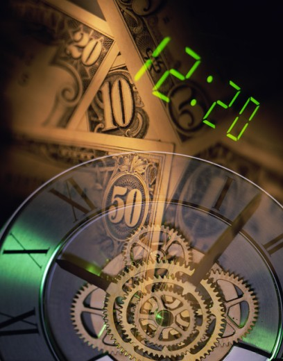 Stock Photo: 1531R-528 Gears of a clock with paper money in the background