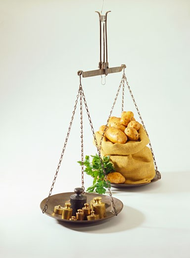 Stock Photo: 1532R-10016 Hanging scales with weights and sack of potatoes