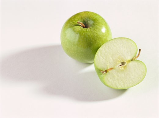Stock Photo: 1532R-10064 Whole and half Granny Smith apple