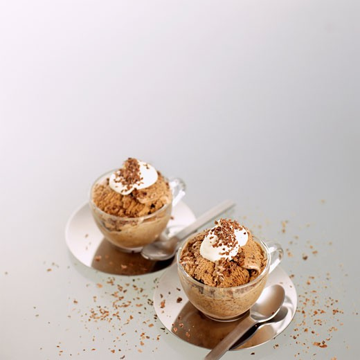 Home-made mocha ice cream in glass cups with whipped cream : Stock Photo