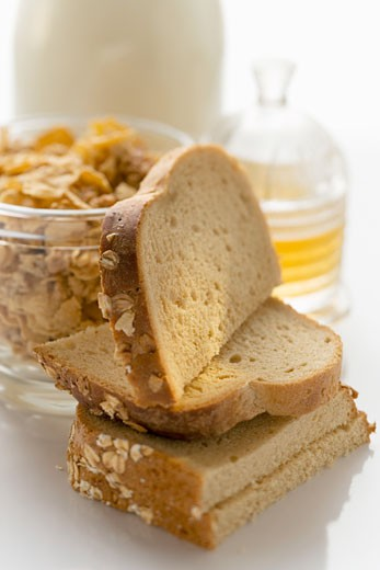 Slices of bread, cereal and honey : Stock Photo