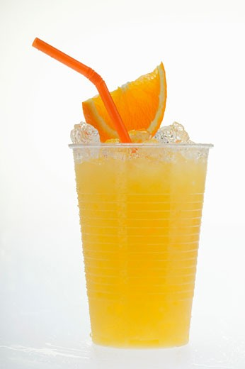 Stock Photo: 1532R-11140 Orange juice with crushed ice, wedge of orange and straw