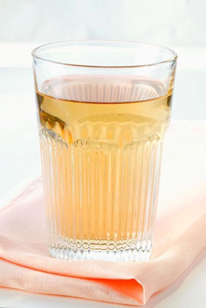 Apple juice in glass on fabric napkin : Stock Photo