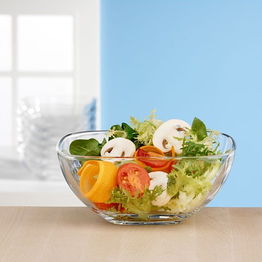Stock Photo: 1532R-12053 Salad ingredients in glass bowl in front of window