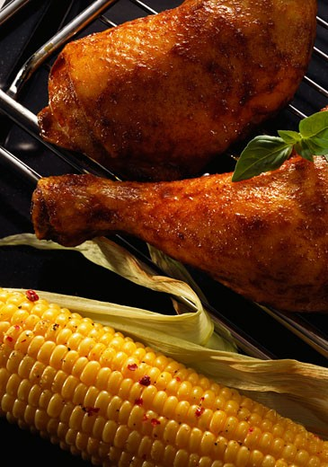 Stock Photo: 1532R-12242 Chicken legs and corncob on the barbecue