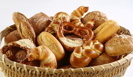 Basket of assorted baked goods : Stock Photo