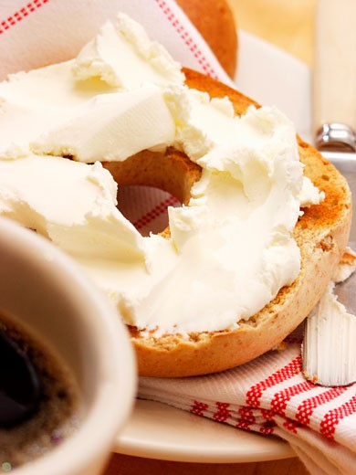 A Toasted Bagel with Cream Cheese and Coffee : Stock Photo