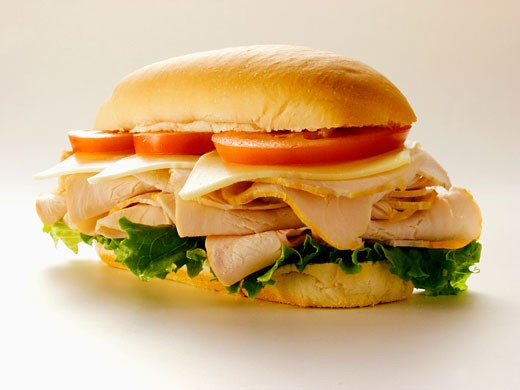Stock Photo: 1532R-13445 A Turkey Sub with Tomatoes, Cheese and Lettuce