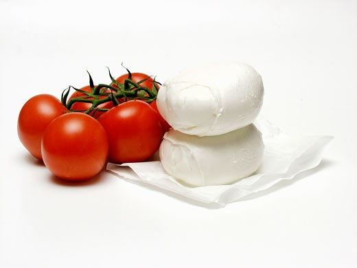 Two Balls of Mozzarella with Several Vine Ripened Tomatoes : Stock Photo