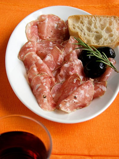 Stock Photo: 1532R-13491 Sliced Genoa Salami and Black Olives and Bread