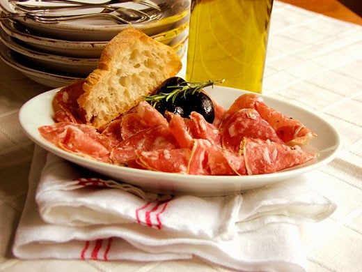 Sliced Salami with Bread and Olives : Stock Photo