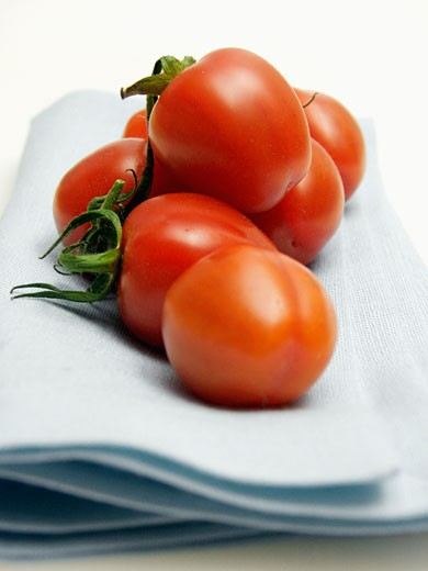 Stock Photo: 1532R-13709 Tomatoes Resting on a Cloth