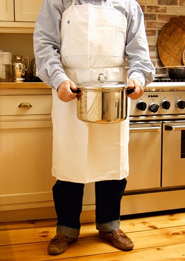 Stock Photo: 1532R-13824 Man Holding a Stock Pot