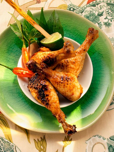 Asian chicken legs with lime and chili peppers : Stock Photo