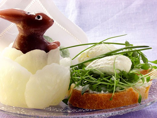 Cream cheese sandwich with cress, wax Easter Bunny : Stock Photo