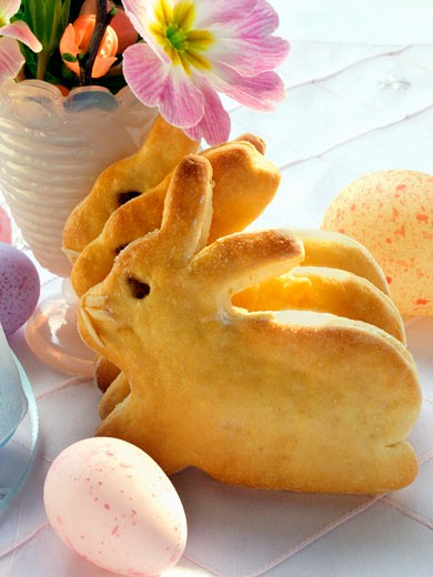 Easter Bunny in bread dough and coloured eggs : Stock Photo