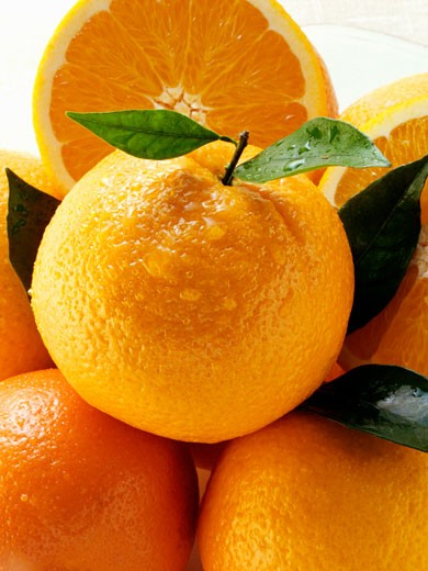 Oranges and orange halves : Stock Photo