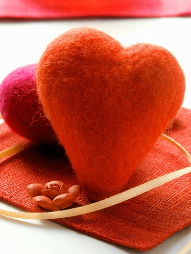 Red hearts as table decoration for Valentine's Day : Stock Photo
