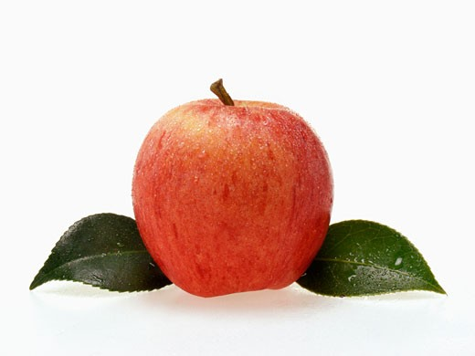 Red apple with leaves and drops of water : Stock Photo