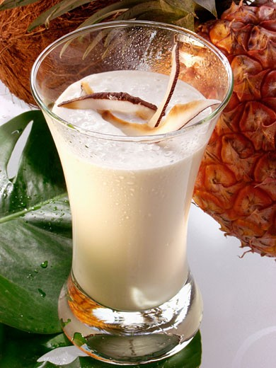 Stock Photo: 1532R-15369 Exotic pineapple and coconut shake in glass