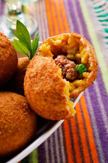 Sicilian rice balls with mince stuffing : Stock Photo