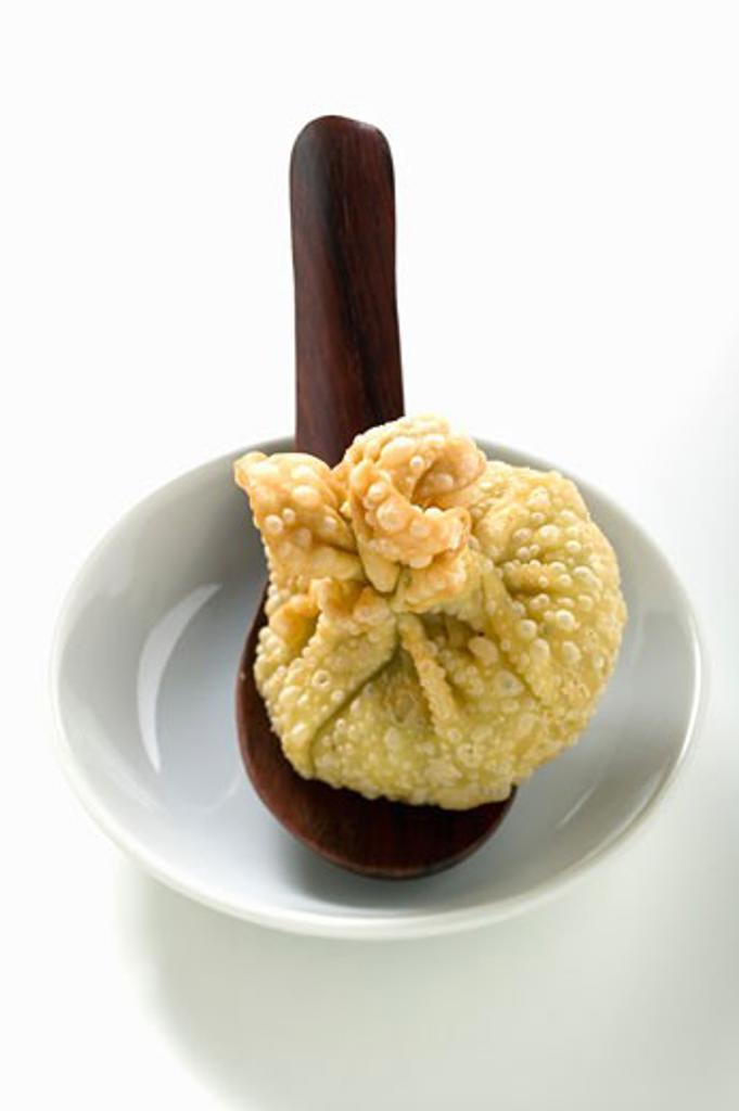 Deep-fried wonton on spoon : Stock Photo