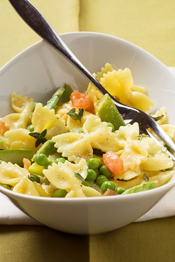 Farfalle with vegetables : Stock Photo