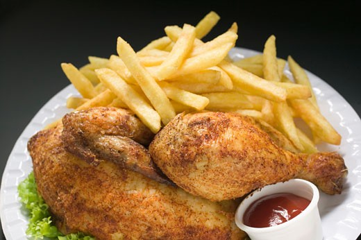 Stock Photo: 1532R-17106 Half a chicken with chips and ketchup