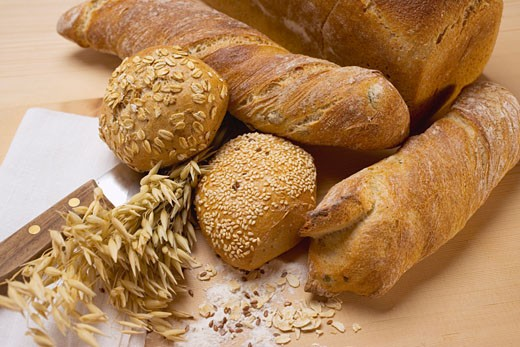 Stock Photo: 1532R-17332 Baguettes, wholemeal rolls, tin loaf and cereal ears