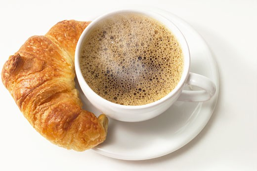 Cup of coffee and croissant : Stock Photo