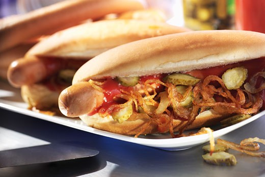 Stock Photo: 1532R-18285 Hot dogs with fried onions and gherkins