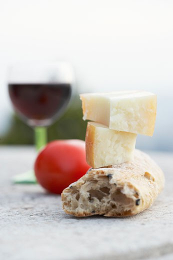 Cheese, bread, tomato and wine : Stock Photo
