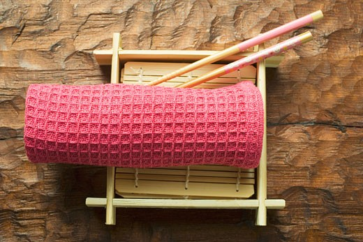 Stock Photo: 1532R-18468 Asian table accessories: hand towel, chopsticks, bamboo mat