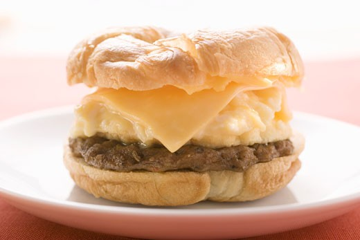 Cheeseburger with scrambled egg on plate : Stock Photo