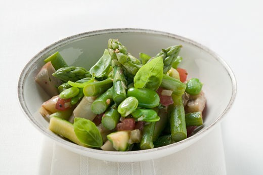 Green asparagus salad with beans and basil : Stock Photo