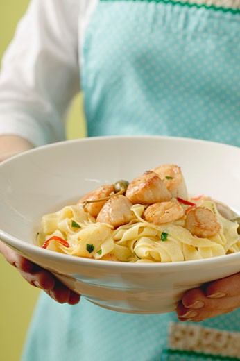 Ribbon pasta with scallops and capers : Stock Photo