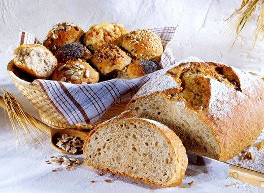 Granary bread and assorted rolls : Stock Photo