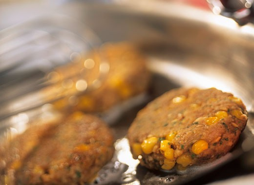 Stock Photo: 1532R-19867 Turkey burgers with sweetcorn kernels