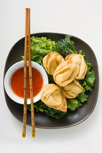 Deep-fried wontons with sweet and sour sauce : Stock Photo