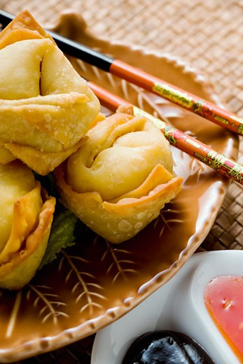 Deep-fried wontons with two sauces : Stock Photo