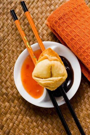 Stock Photo: 1532R-20695 A deep-fried wonton with two sauces