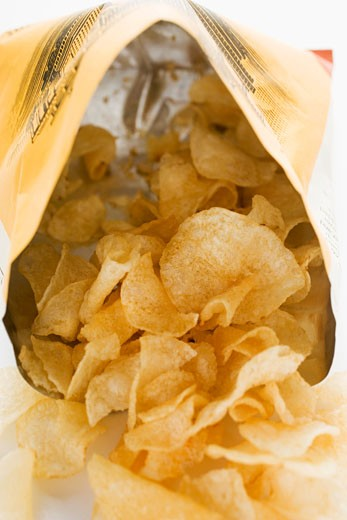 Potato crisps in opened bag : Stock Photo
