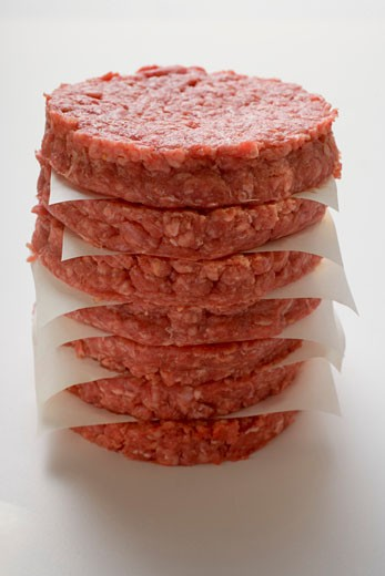 Stock Photo: 1532R-21017 Raw burgers for hamburgers, in a pile