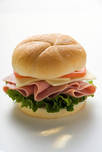 Ham, cheese and tomato in kaiser roll : Stock Photo