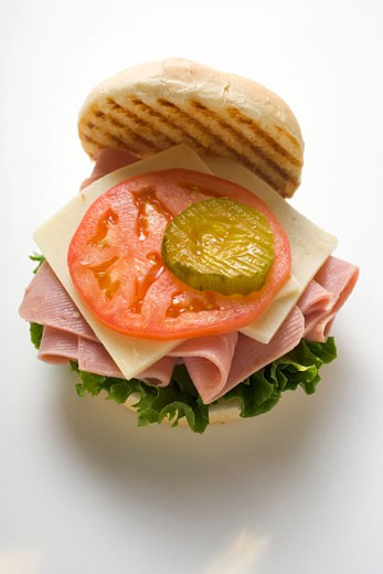 Ham, cheese, tomato and gherkin in kaiser roll : Stock Photo