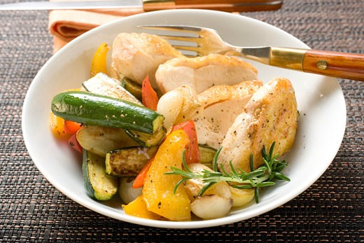 Fried chicken breast with mixed vegetables : Stock Photo