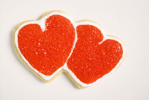 Double heart-shaped biscuit decorated with red sugar : Stock Photo