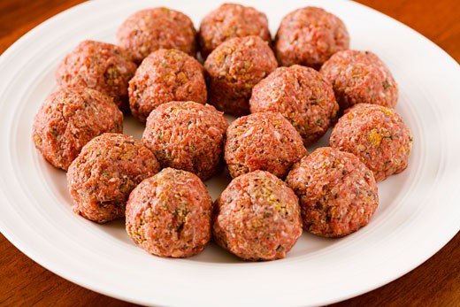 Stock Photo: 1532R-21999 Raw meatballs on a plate