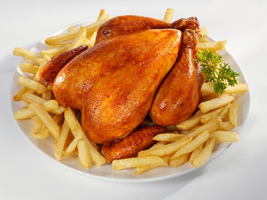 Roast chicken with chips : Stock Photo